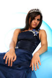 Girl in an blue evening dress and with a diadem Stock Photography
