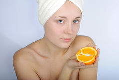 Girl with blue eye with towel on head Stock Images
