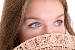 Girl with blue eyes closeup Stock Photos