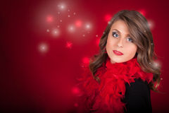 Girl With Blue Eyes On Red Christmas Background Royalty Free Stock Photography