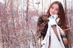 Girl with blue eyes wrapped in a blanket in the winter Stock Photo