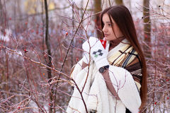 Girl with blue eyes wrapped in a blanket in the winter Stock Photography