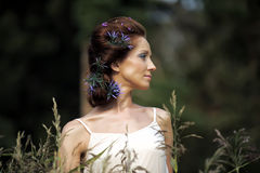 Girl with blue flowers in her hair Royalty Free Stock Photography
