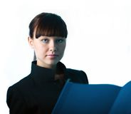 Girl with blue folder. Girl in black jacket with blue folder royalty free stock photo