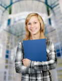 Girl with blue folder Stock Photography
