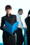 Girl with blue folder and men with women stock images