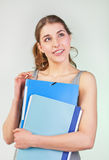Girl with blue folders Royalty Free Stock Photography