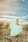 The girl in the blue gown Royalty Free Stock Image