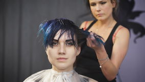 The girl with blue hair in a beauty salon. stock video footage