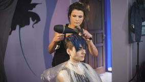 The girl with blue hair in a beauty salon. stock footage
