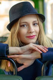 Girl in a blue hat sitting in the bus Stock Images