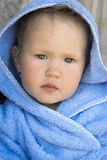 Girl in a blue hood Stock Images