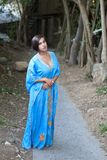 Girl in blue indian dress. Over dark alley Royalty Free Stock Photography