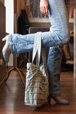 Girl in blue jeans with denim handbag Stock Photography
