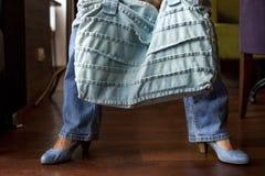 Girl in blue jeans with denim handbag Stock Image