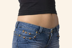 Girl in blue jeans short shorts isolated. On white background Stock Photos