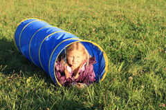Girl in blue kids tunnel Stock Images