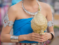 Girl in blue local thai suit in wax festival. Stock Photography