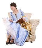 Girl in blue lond dress  with book on chair. Isolated Royalty Free Stock Photography