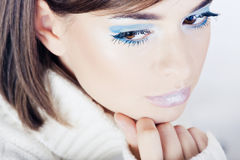 Girl with blue makeup Royalty Free Stock Image