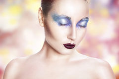 Girl with blue makeup. Stock Photography
