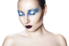 Girl with blue makeup. Royalty Free Stock Photo
