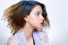 Girl with blue makeup and dyed hair Stock Image