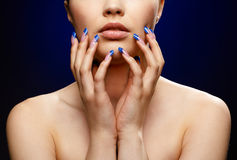 Girl with blue manicure. Close-up portrait of girl with blue manicure royalty free stock image
