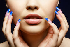 Girl with blue manicure Royalty Free Stock Image
