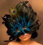 Girl in Blue Mardi Gras Mask Royalty Free Stock Image