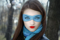 Girl in blue mask. In the park Stock Images