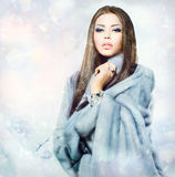 Girl in Blue Mink Fur Coat Stock Photo