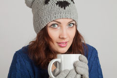 Girl in blue with a mug Stock Photos