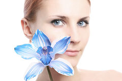 Girl with blue orchid Stock Photography