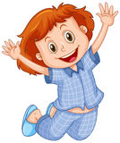 Girl in blue pajamas jumping Stock Photography