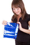 Girl with blue paper bag Stock Image