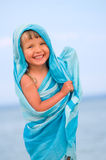 Girl in a blue pareo. Smiling child on a beach Royalty Free Stock Images