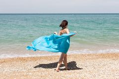 Girl in blue pareo on beach Royalty Free Stock Photography
