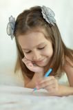Girl with blue pencil Stock Image