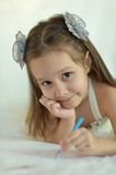 Girl with blue pencil. ??ute little girl is playing with blue pencil royalty free stock images
