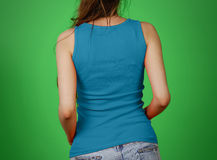 A girl in a blue plain t-shirt. Empty tank top. Closeup. Isolate Royalty Free Stock Photography