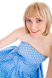 Girl in a blue polka dot dress Stock Images