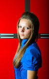 Girl in blue at red background Royalty Free Stock Image