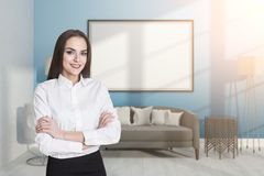 Girl in a blue room with a whiteboard Royalty Free Stock Images
