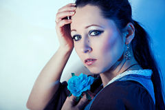 Girl and blue rose Royalty Free Stock Images