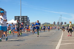 Girl in blue running at marathon run in Belgrade, Serbia Stock Photography