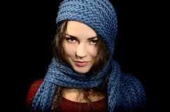 A girl with a blue scarf. On a black background. Portrait. Christmas story Stock Photography