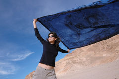 Girl with a blue shawl on a windy day. Stock Photo