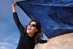 Girl with a blue shawl on a windy day. Stock Photography