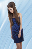 Girl in blue shiny dress Stock Photos